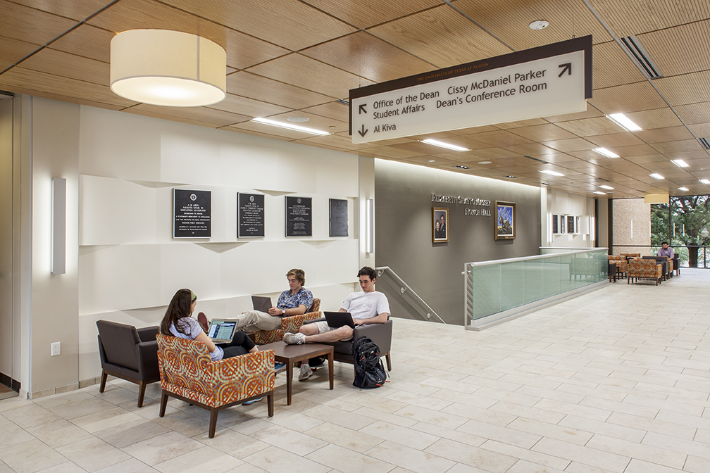 Image of the UT Sanchez Public Area Renovation that includes students in chairs and a view of the stairwell entrance